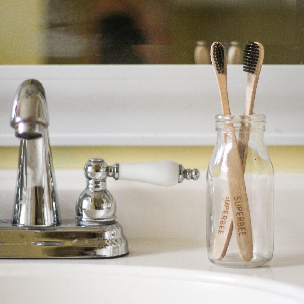 Bamboo Toothbrush next to Sink